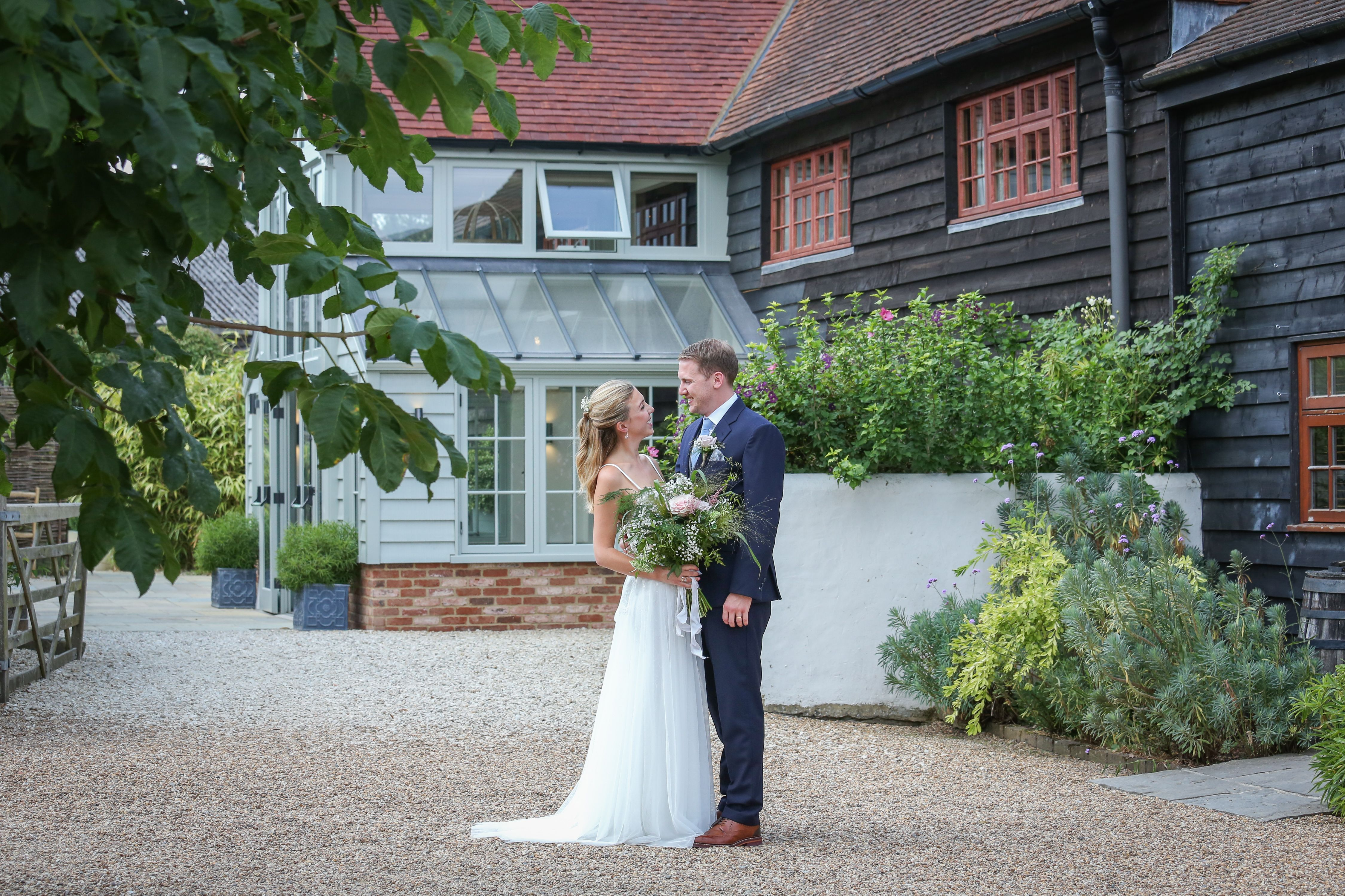 088150a20bdd Real bride Lucy wears Lupine gown by Willowby for her church wedding at Gate  Street Barn near Guildford. Photo by VLA Wedding photography.