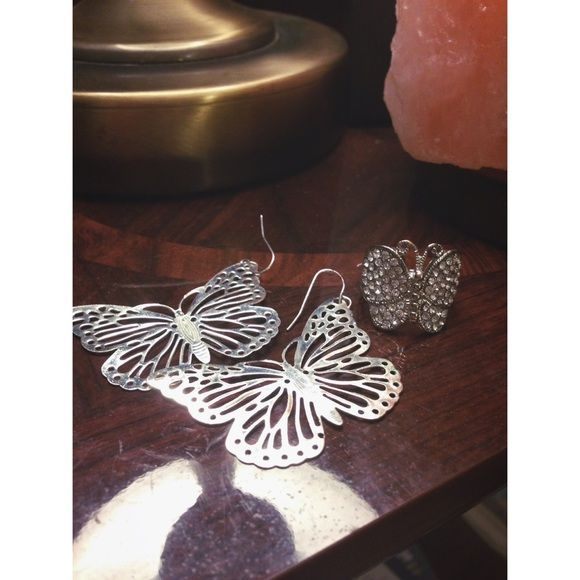 Butterfly Silver Earrings  (plus ring) They are silver and petite. I'm not a fan of the ring and there is a tiny bit of wear on it so it will come with the earrings! It was a gift, they have been loved! Jewelry Earrings
