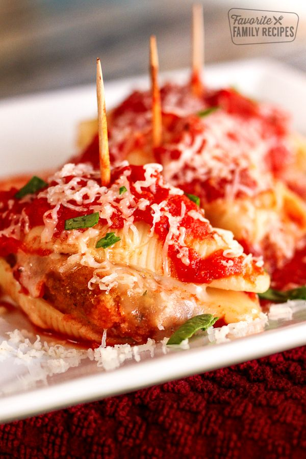 These Chicken Parmesan Stuffed Shells are the perfect weeknight meal! Also great when served as an appetizer. Easy to make & only a few simple ingredients!