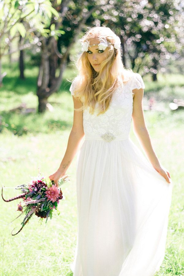 Stunning sheer capped sleeve lace Ivory wedding dress with high neck and silk chiffon skirt. $999.00, via Etsy.