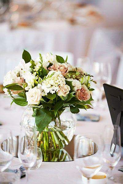 Floral Table Centrepieces Displayed In Fishbowl Vases Wedding