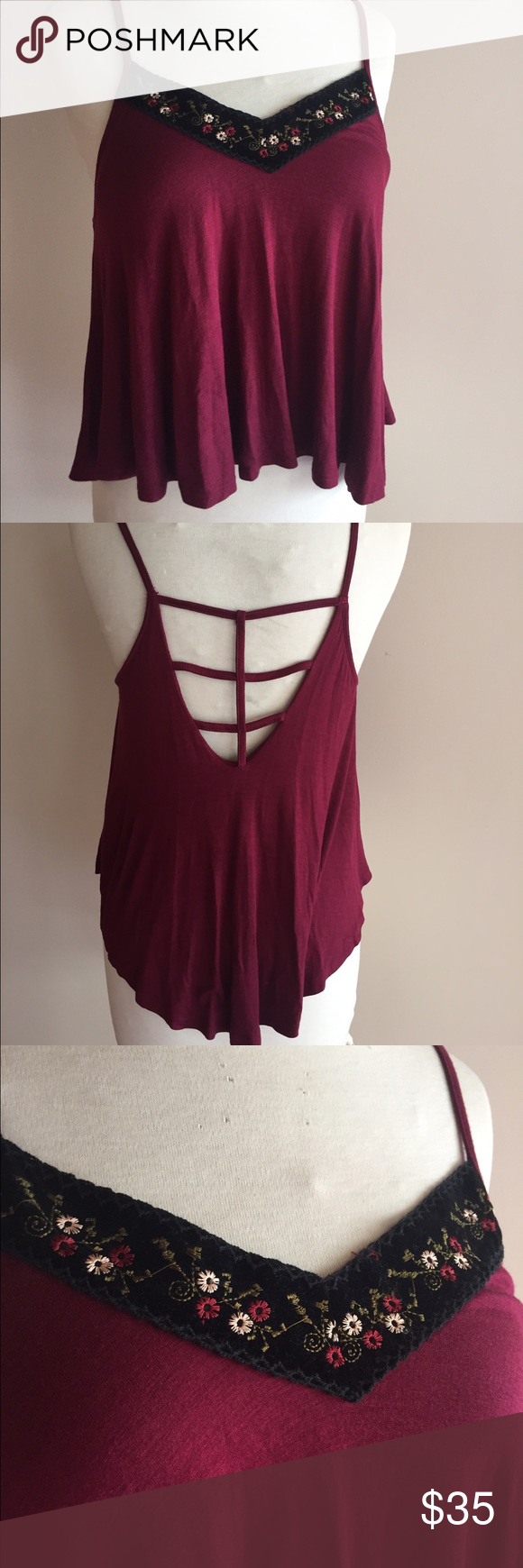 NWOT Burgundy Crop top Burgundy swing crop top. With velvet embroidered at the neck line and caged style back. Has built in bra. Super soft! Monteau Tops Crop Tops