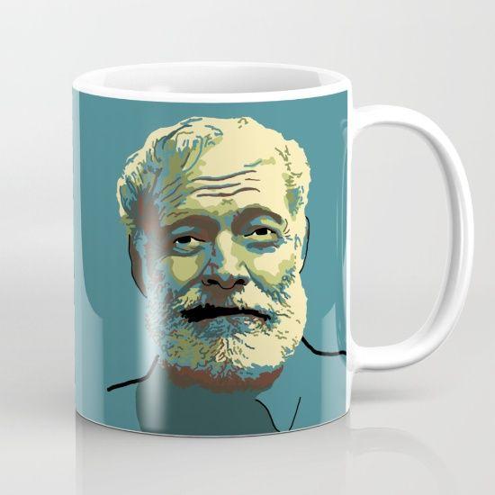 Teal coffee mug with portrait of Ernest Hemingway.