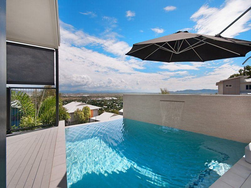 pool with a view. I like the umbrella over the pool for shade