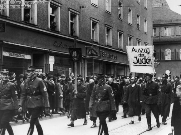 The Morning after the Night of Broken Glass [Kristallnacht] in Regensburg: Jews are Led to the Train Station (November 10, 1938) A total of 224 Jewish men from the entire administrative district of Lower Bavaria and Upper Palatinate were sent to Dachau.