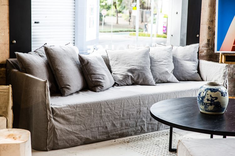 Loose Grey Linen Slipcovered Sofa