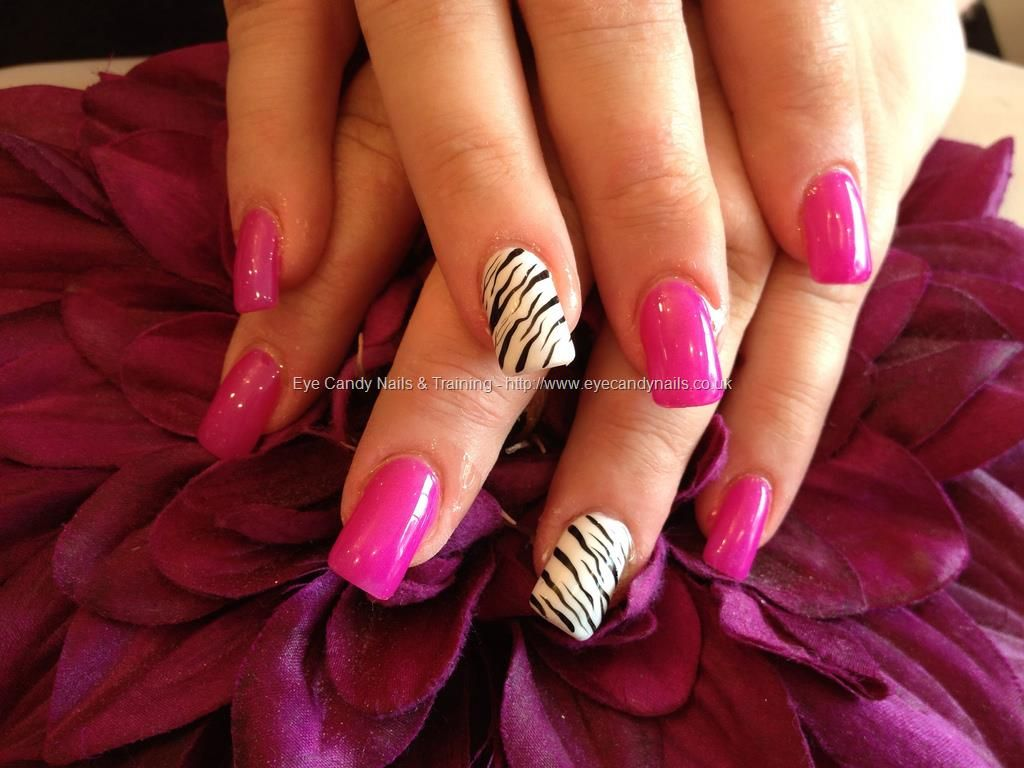 Full set of acrylic nails with zebra print nail art on ring finger ...