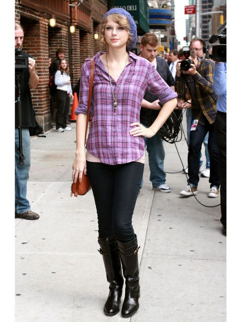We rarely see pics of Taylor off the red carpet, but we love her casual everyday style!  The plaid shirt pays homage to her country routs, but the sleek boots and cool beanie is 100% city slicker. Plus, were having major bag envy over that cute cross body.