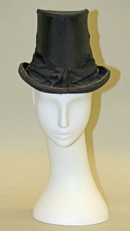 "Black silk riding hat, French, 1878. Label: ""Exposition Universelli / 1878 / Seul Medaille"""