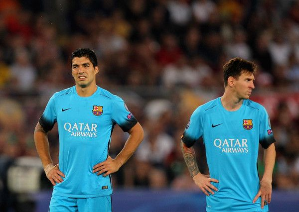Luis Suarez and Lionel Messi of FC Barcelona look on during the UEFA Champions League Group E match between AS Roma and FC Barcelona at Stadio Olimpico on September 16, 2015 in Rome, Italy.