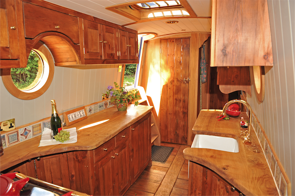 Canal/Narrow boat  bespoke narrowboat interiors Love the fitted cabinet over the port hole window.