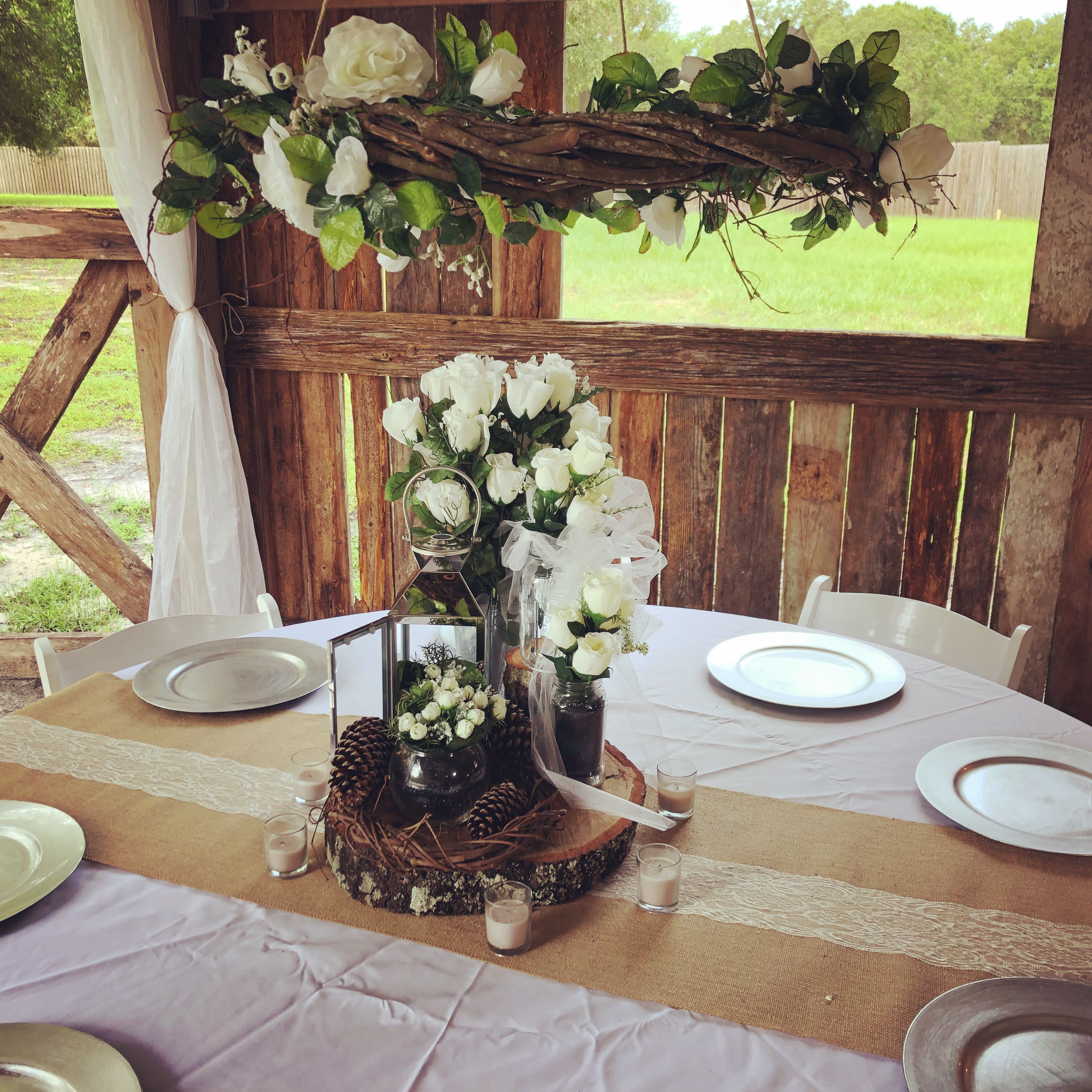 Rustic Wedding Decorations For Indoor And Outdoor Settings: Love The Centerpieces And The Grape Vine And Rose Wreath