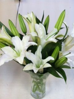 White lilies are sophisticated and beautiful. This large flower definitely does not want to be over-shadowed by anyone else, so get these in a statement arrangement.
