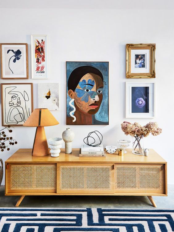 Gallery wall and cane console with navy Anatolia maze rug in Blueberry by Kevin Francis Design on Thou Swell #arearug #rug #rugdesign #mazerug #maze #luxuryrug #tuftedrug #woolrug #patternedrug #homedecor #homedecorideas #luxurydesign