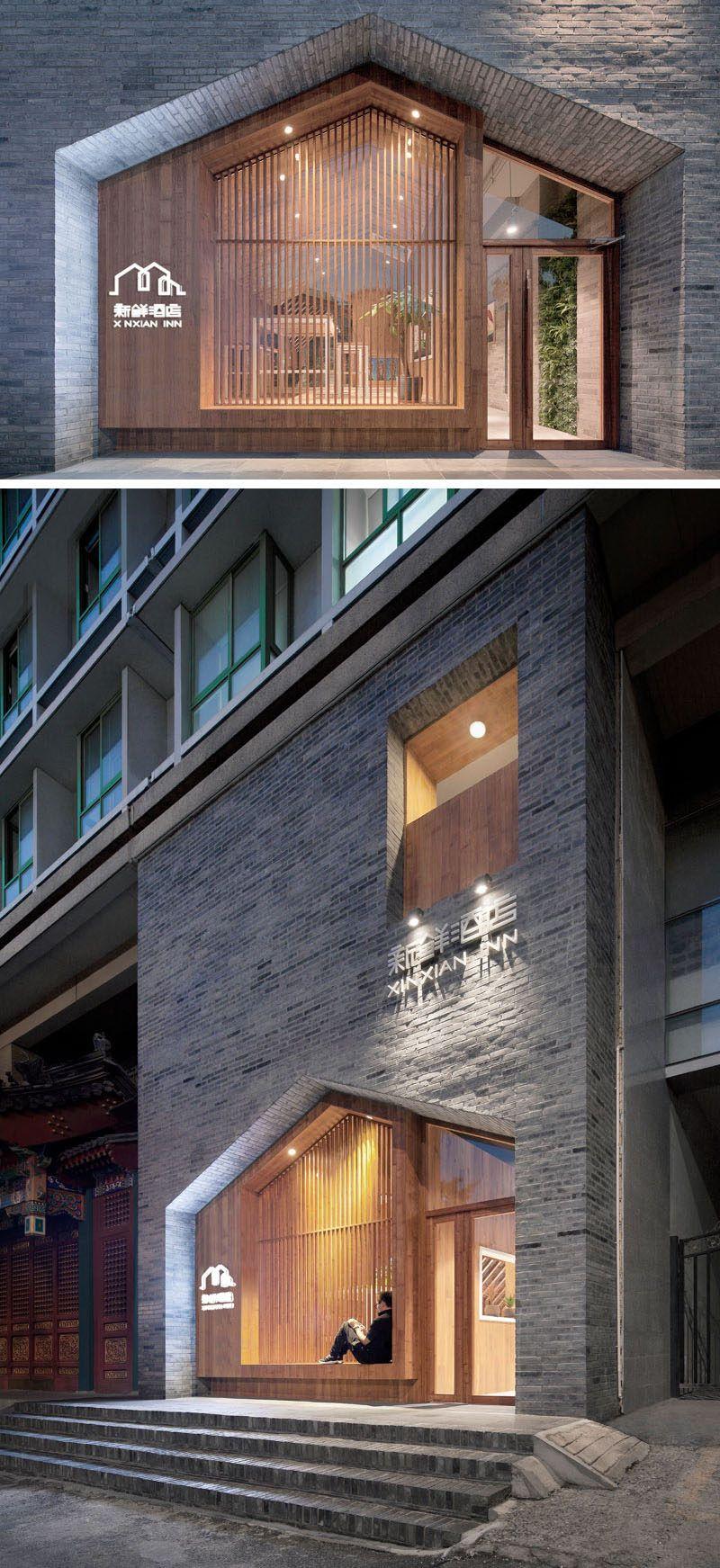 Exterior modern siding window design  gray bricks and wood work together to create a contemporary facade