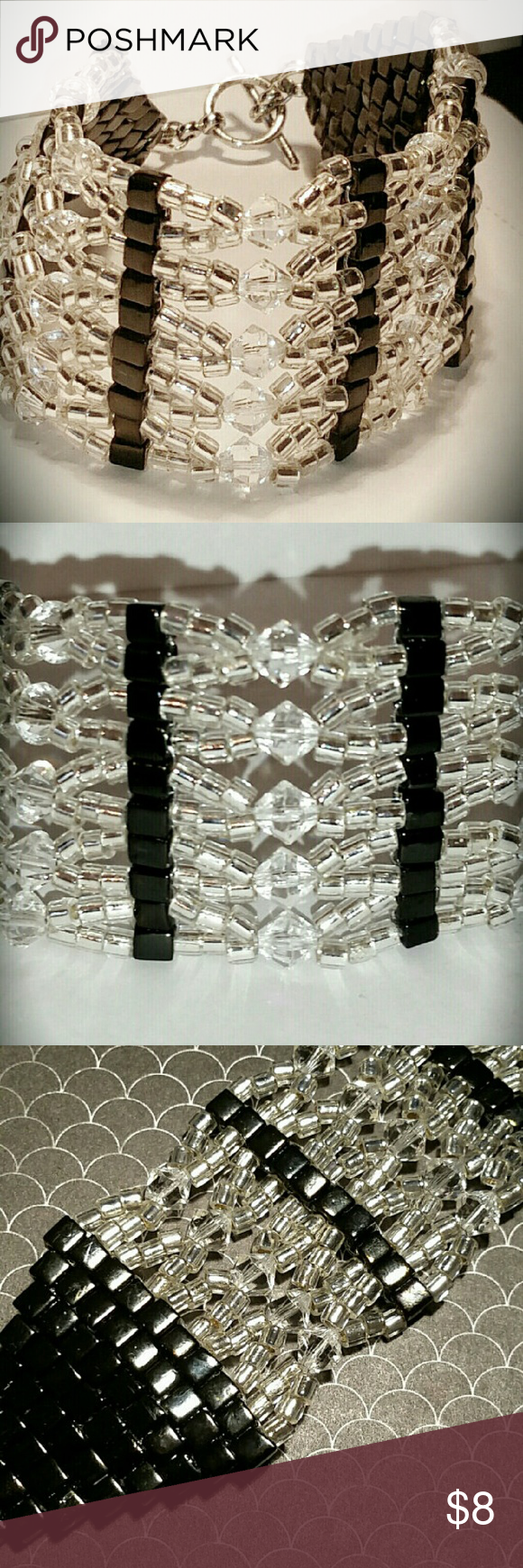 Silver and Black Cuff Beaded Bracelet This cuff bracelet is made of black ab square beads, silver lined seed beads, and 6mm clear swarovski crystal bicones.     It Is about a  size 9 and its really a nice bracelet. Jewelry Bracelets