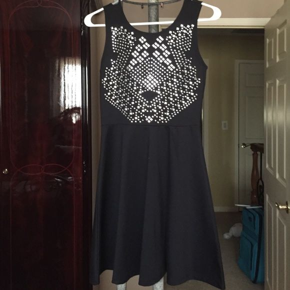Black with silver studs polyester a-line dress! Only worn once! In perfect condition a beautiful trendy black dress! I cut the tag off because it was itching me:( I wore it for New Year's Eve! Perfect for any occasion  Dresses Asymmetrical