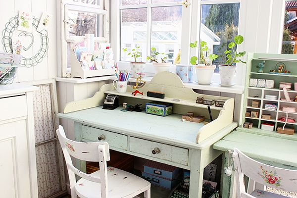 A Tilda Filled Pastel Craft Room - like the white card holder/stand