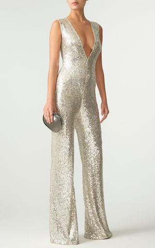 37c54962c86e This   Naeem Khan   jumpsuit features a V-neckline