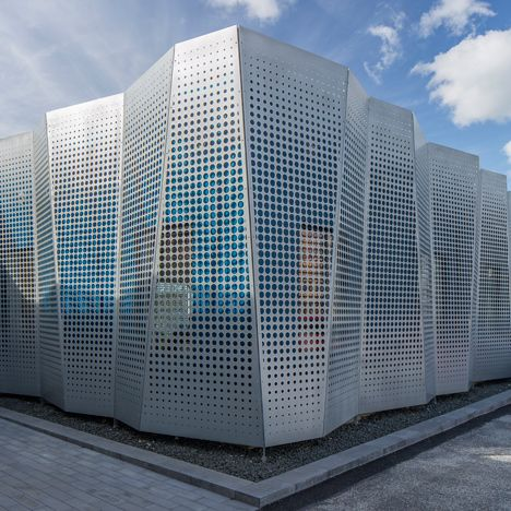 perforated metal sheets concertina across the facade of an