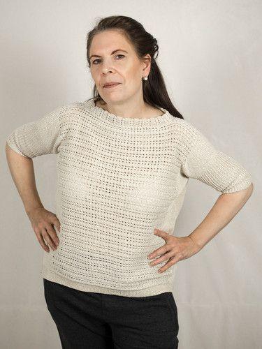Stilsicher zurück in der Zeit – DasTeil für Dich.  Durch Muster und Schnitt von den 70ern inspiriert verleiht der Pullover im Gitter-, Muschel- und Perlenmuster Deinem Outfit einen eleganten Retrolook.