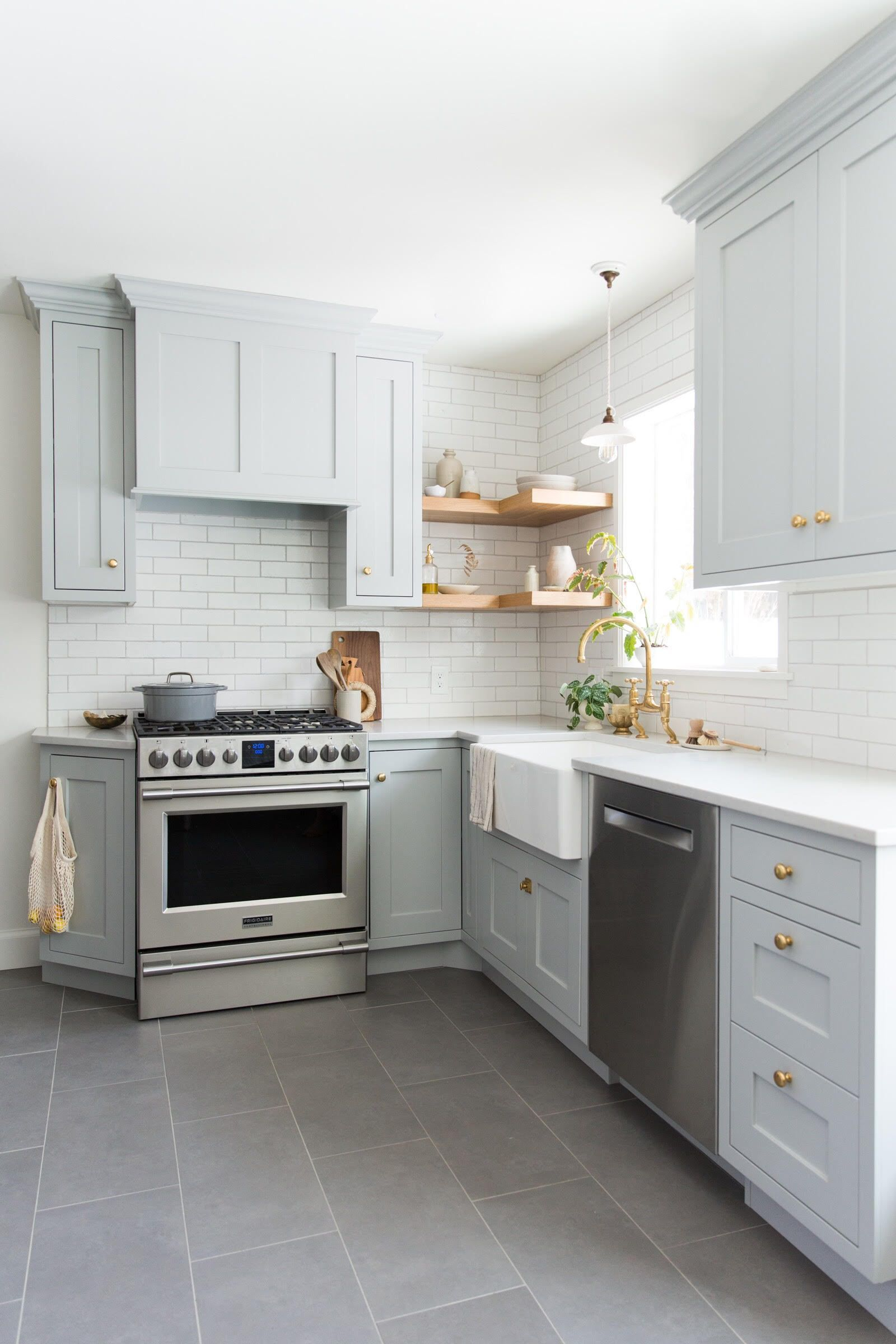 This sleek, traditional kitchen features our Glazed Thin Brick in Olympic on the…