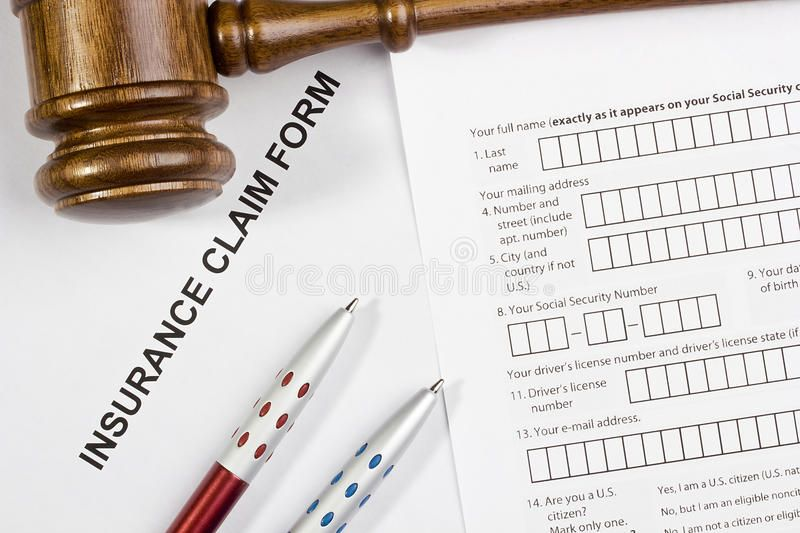 Insurance Claim Form. Directly above photograph of an