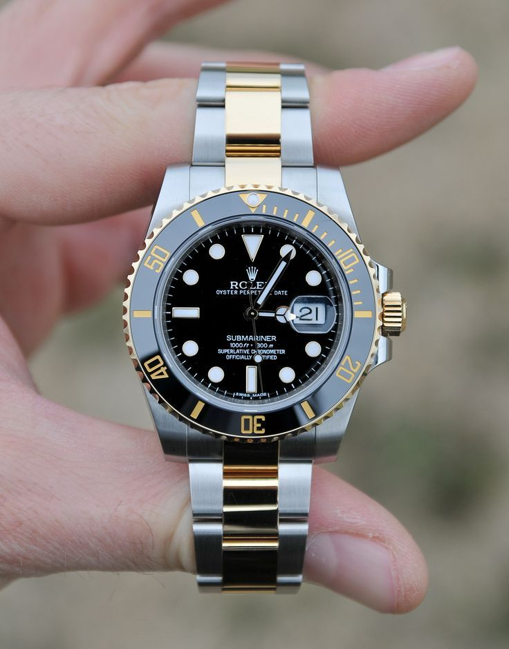 Rolex Submariner. With the new ceramic bezel which is scratch proof. 18k gold and stainless steel links and case. What a beautiful watch.