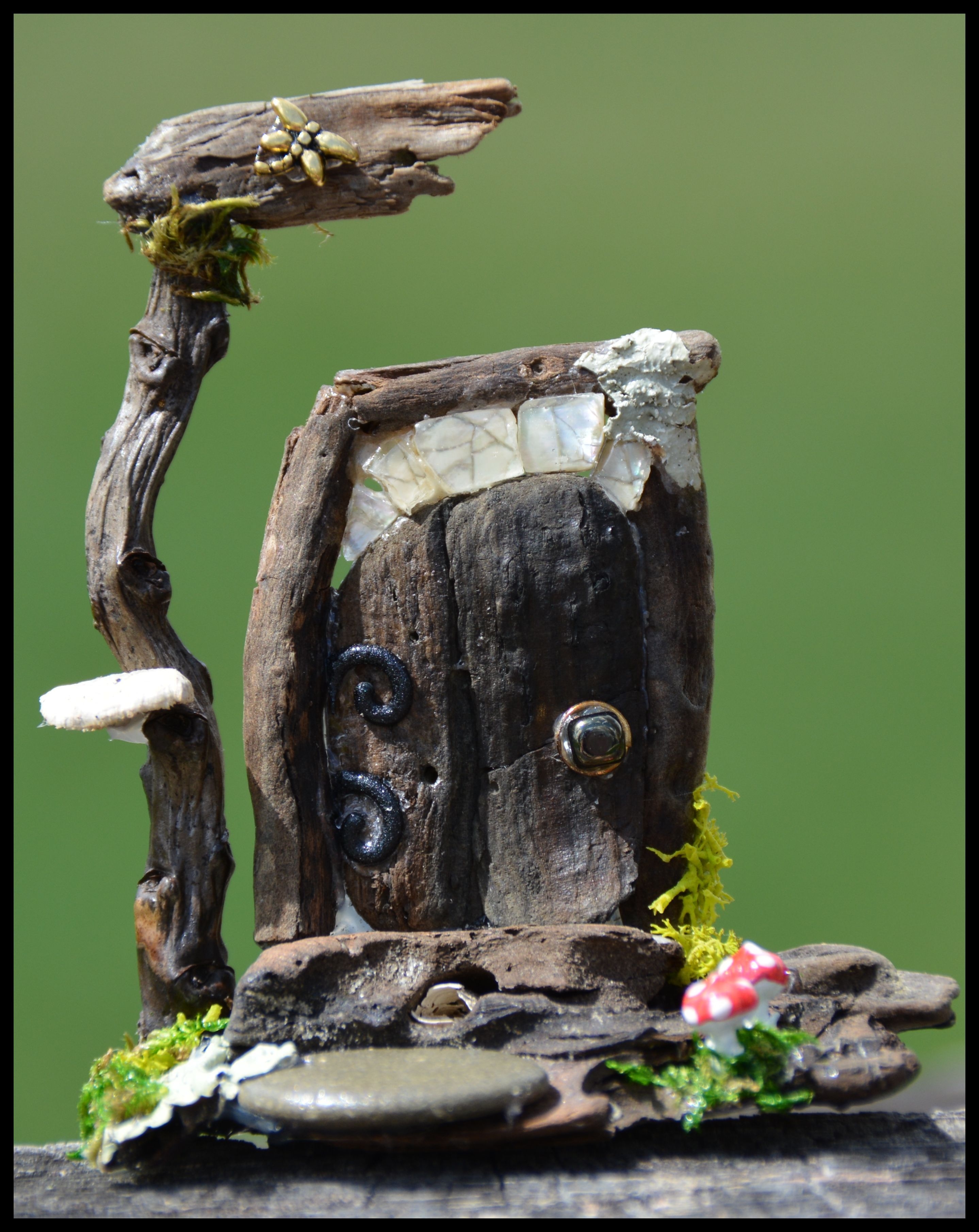 Miniature Faery Garden fairy door I created from driftwood, stones, and tree fungus.