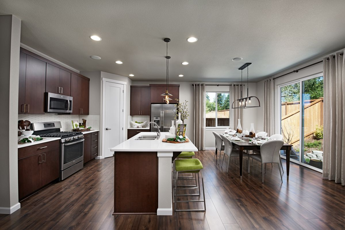 Dark Cabinets White Countertops In A Thoughtfully Designed Kitchen Lafayette Model Home Lacey