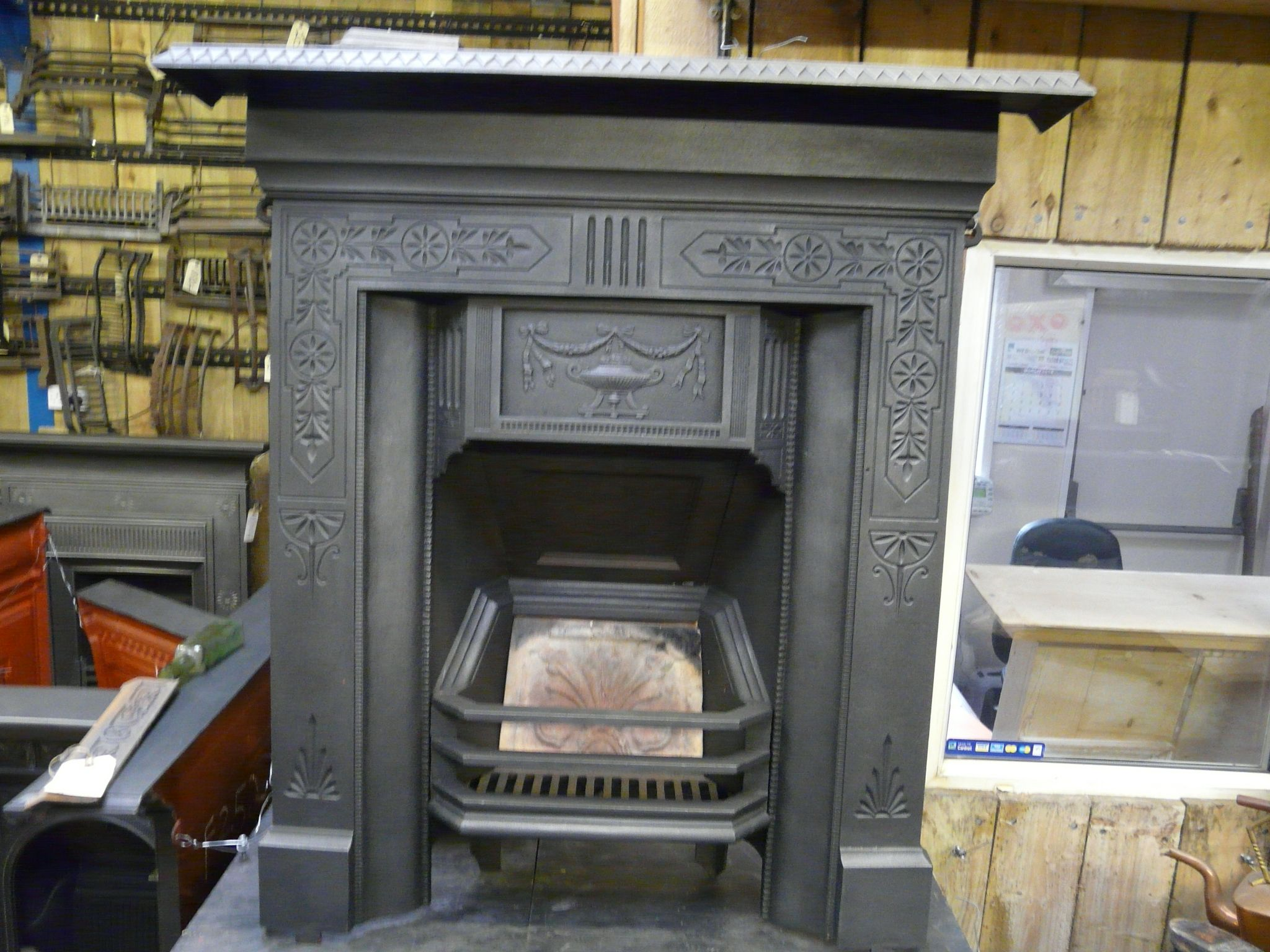 Victorian Cast Iron Fireplace With Geometric Design And A Urn