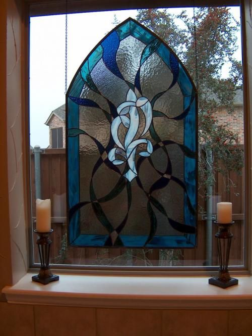 Hanging arched abstract stained glass panel for a bathroom