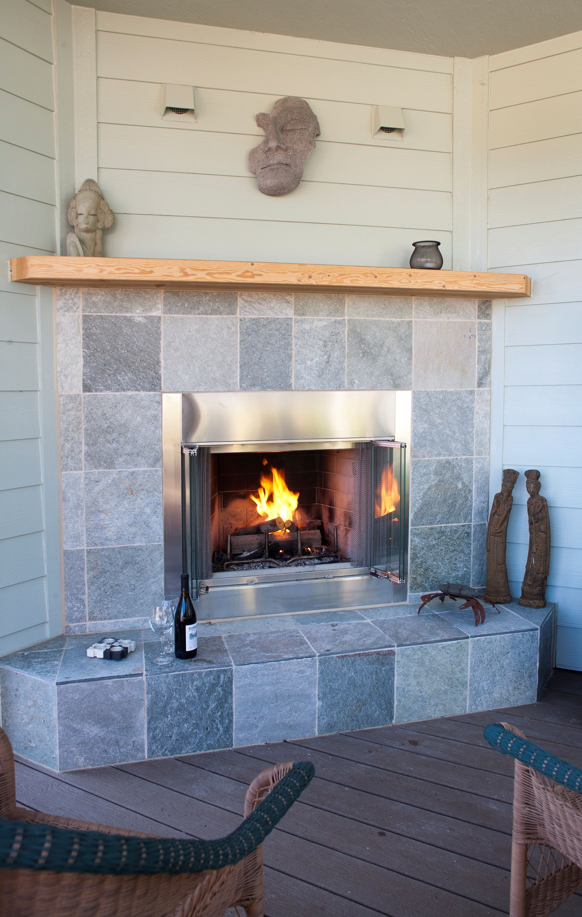 Enjoy a fire on your porch!  Estes Builders designs and builds new homes in Port Angeles, Sequim, Port Townsend, Kingston, Hansville, Poulsbo, Bainbridge Island, Bremerton, Silverdale, Port Orchard and surrounding Clallam and Kitsap Peninsula neighborhoods.