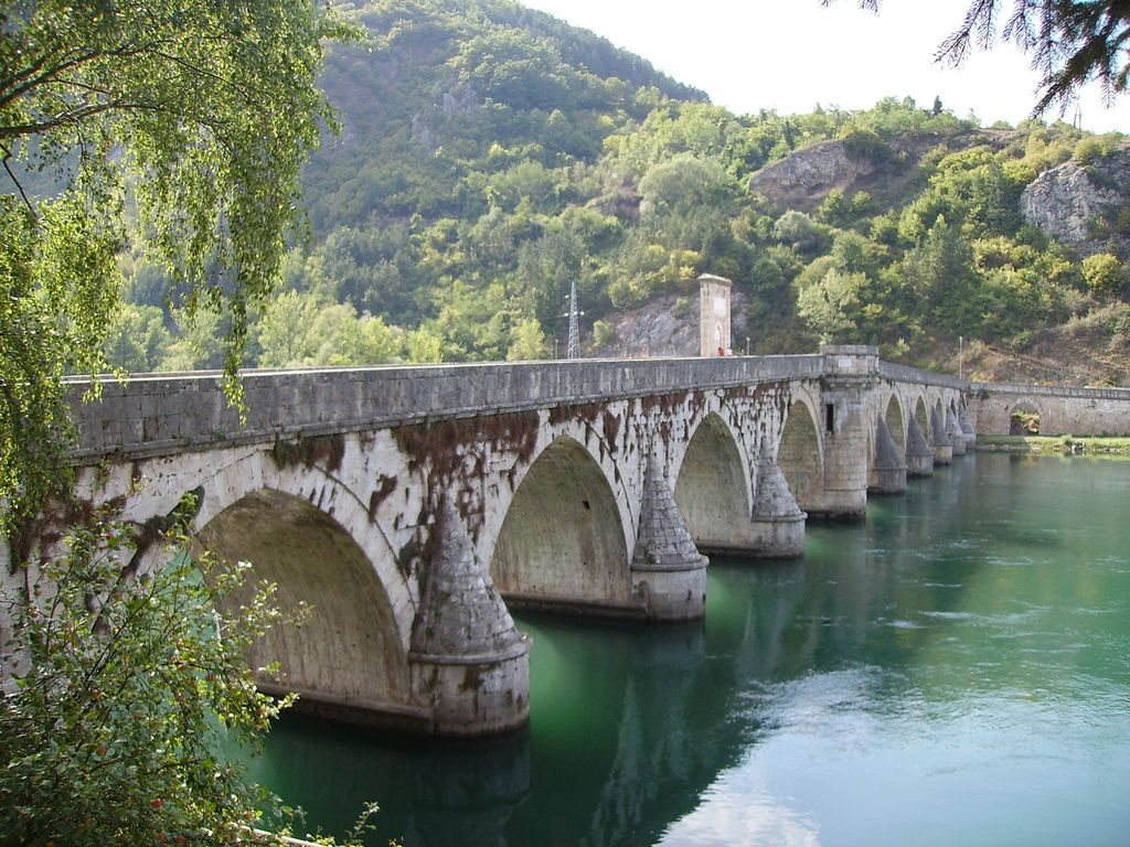 Bridge on River Drina in Višegrad Bosnia...Characteristic of the apogee of Ottoman monumental architecture and civil engineering, the bridge has 11 masonry arches with spans of 11 m to 15 m, and an access ramp at right angles with four arches on the left bank of the river.  The 179.5 m long bridge is a representative masterpiece of Sinan, one of the greatest architects and engineers of the classical Ottoman period.