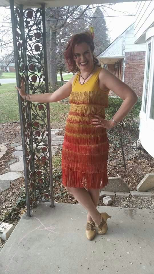 1920 ' s flapper dress I made from orginal dress from thrift store.  Bought lots of gold fringe, and preceded to paint it in gradations.  Bottom fringe I  dyed bright red.