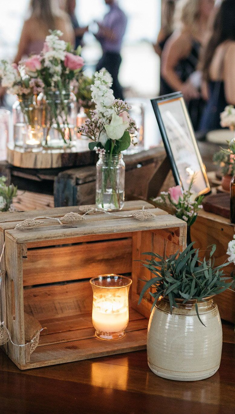 Rustic wedding decor - wooden crate and glass jar filled in native flowers #weddingdecor #weddingdecoration #rusticwedding