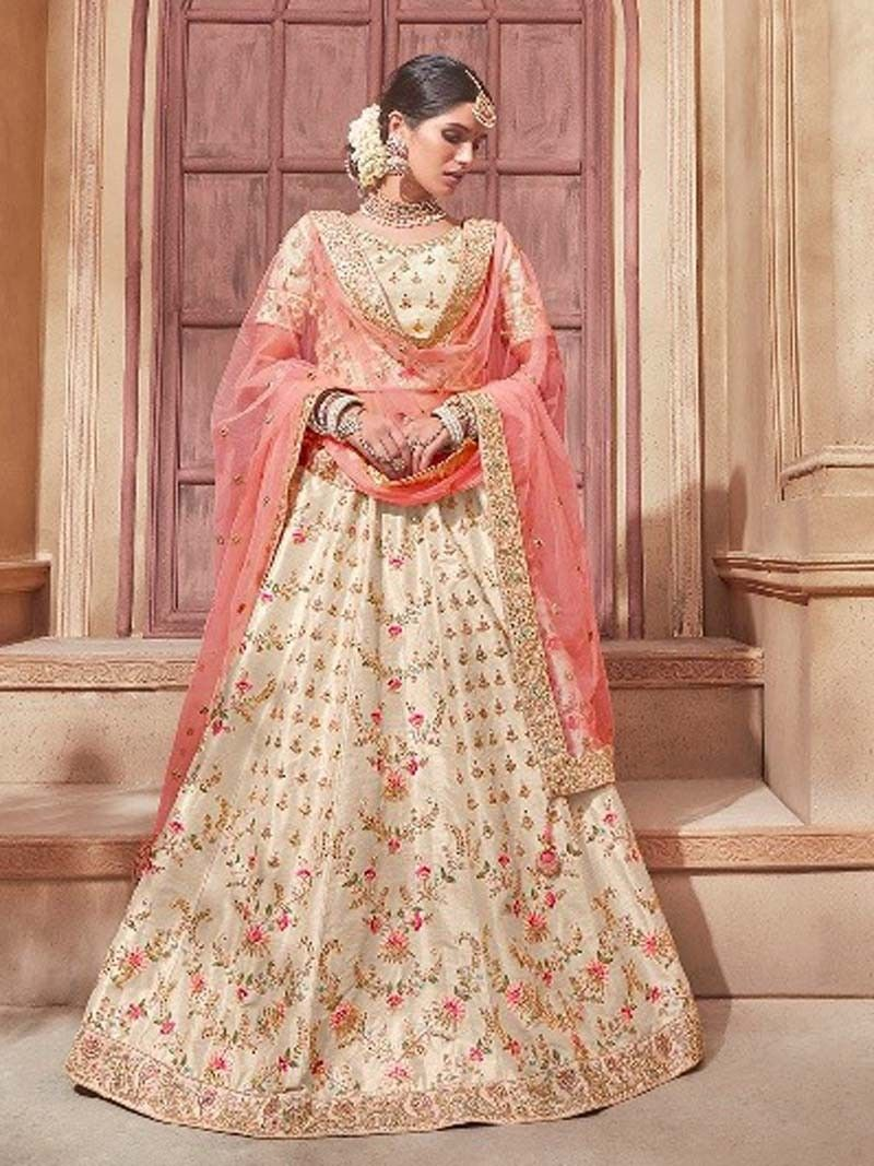 716312c1a1 Latest Bollywood style indian designer off white color embroidered lehenga  choli with peach dupatta