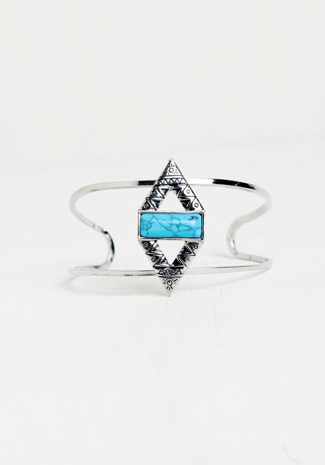 Etched with geometric designs and a rectangular turquoise-hued stone in the middle, this cuff will be one of your go-to's.