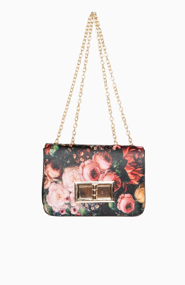 Fun, floral purse from dailylook.com. This will look great with a plain white shirt, dark blue jeans, black heels, and a bold lip. Simple and chic.