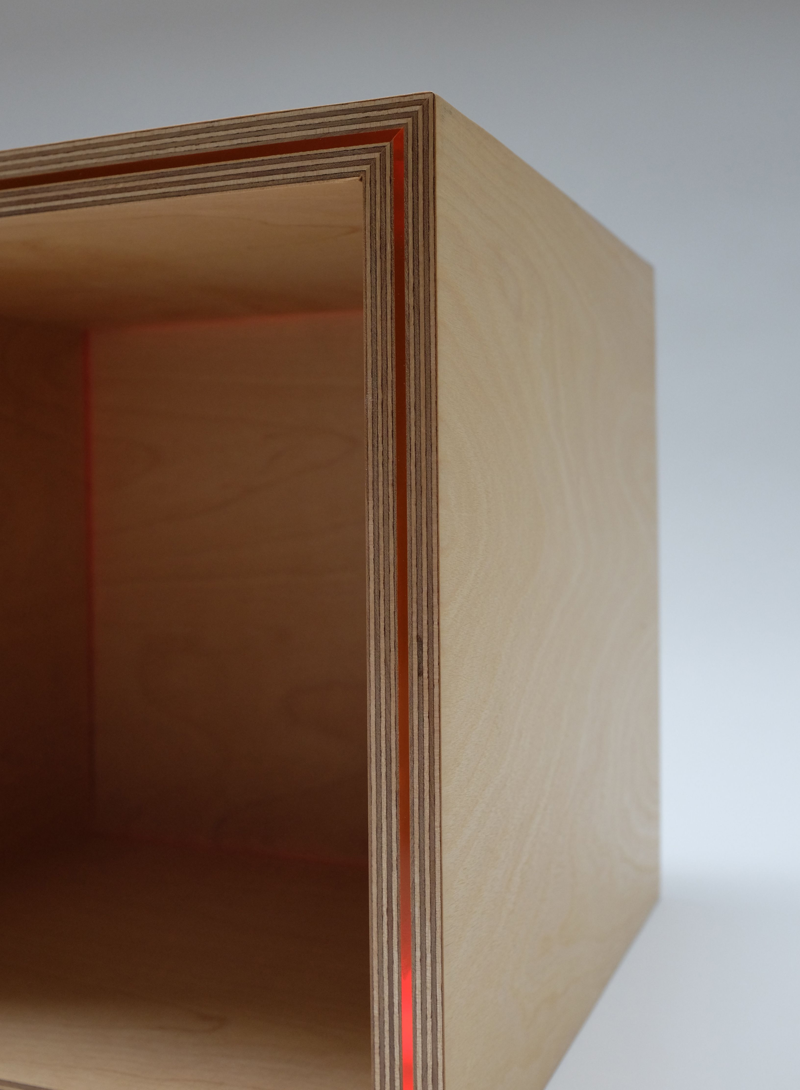 ODDBOX 2 Orange acrylic sandwiched between birch ply, backlit with LED light source, making the acrylic glow. Internal back panel is edge lit, and glows a lovely orange. Can be made any size, with different coloured acrylic, different wood for the box (could be oak, walnut, aluminium clad - the choice is yours!