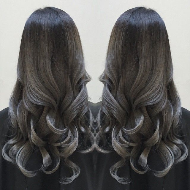 Smoky silver highlights over charcoal black hair color ...