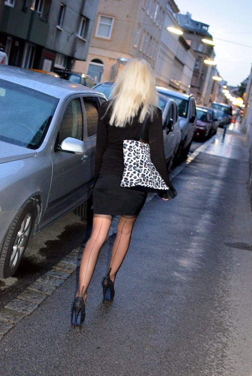 Candid seamed stockings in public