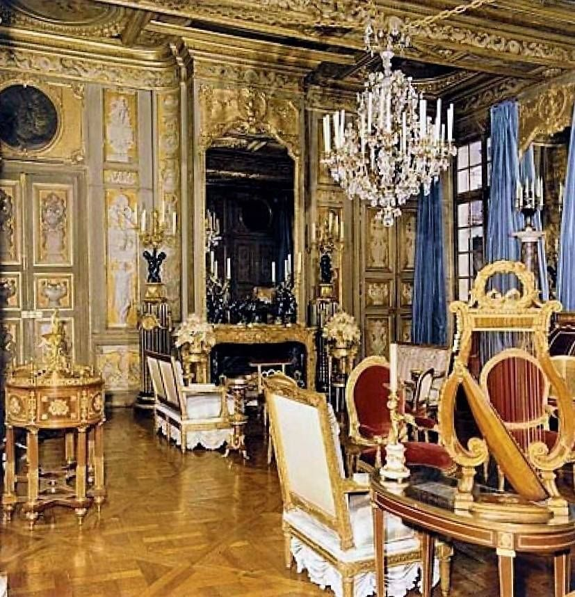 Carved and gilded paneling in this Louis XVI furnished salon ...