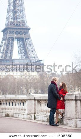 Romantic couple in love dating near the Eiffel Tower in Paris - stock photo