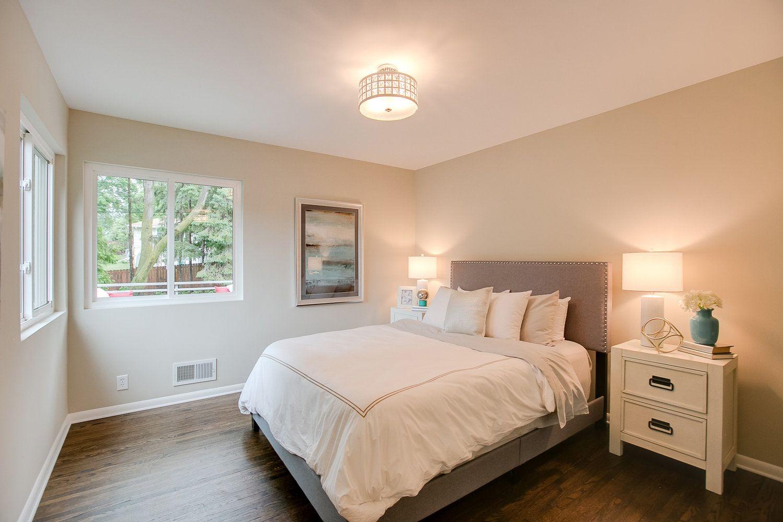 Master bedroom hardwood floors  Beautiful master bedroom with chandelier mirrored closet doors