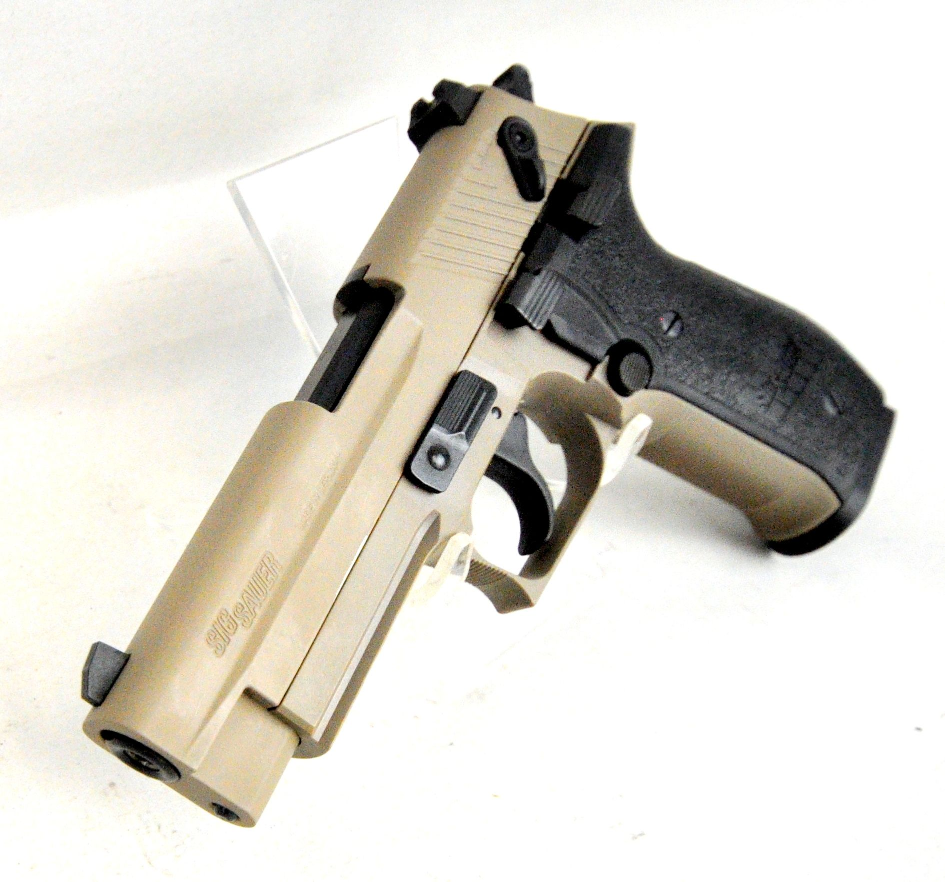 "Sig Sauer Mosquito FDE .22 LR. The Mosquito from Sig Sauer is a scaled down, rimfire version of their popular P226, and is ideal for plinking. It is ergonomically built on a tough polymer frame and features an integral accessory rail, rugged blowback system, adjustable sights, and multiple safety devices. Flat Dark Earth finish. 10-round capacity of .22 LR. 3.9"" barrel. 24.6 oz. [New in Box] $299.99"