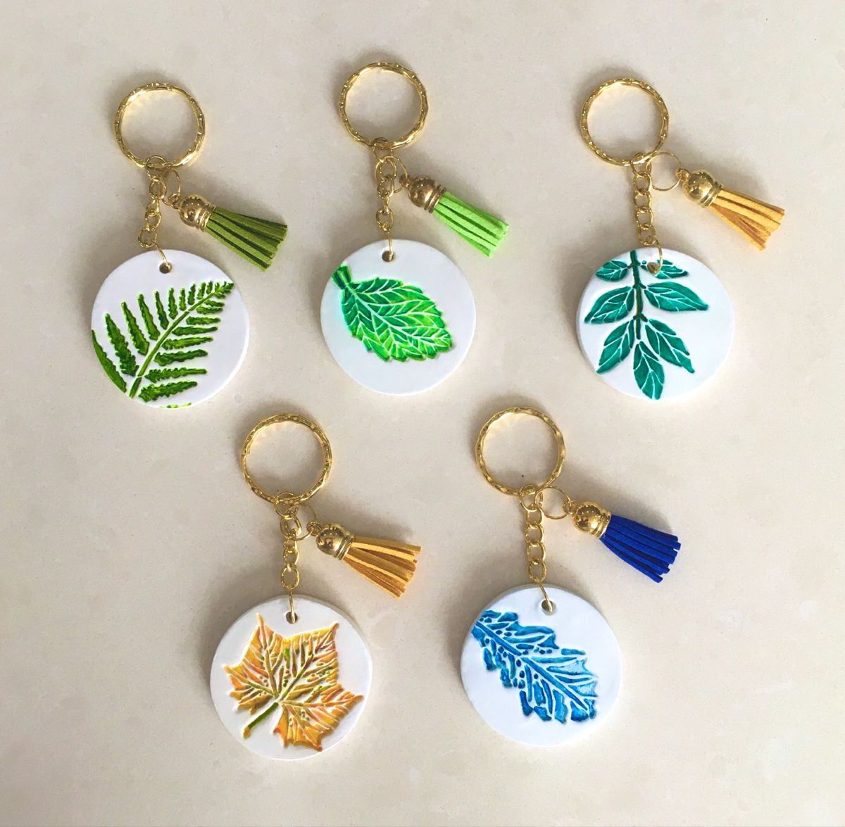 Air Dry Clay Keychains With Leaf Stamps Diy Air Dry Clay Polymer Clay Jewelry Diy Clay Crafts Air Dry