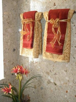 Layered Red And Gold Hand Towels Trending In Bathroom Decor Luxurious Fall Linens From Bathroom Fall Bathroom Decor Bathroom Towel Decor Decorative Towels