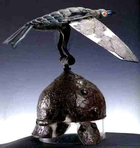 Celtic helmet topped by a bird with movable wings that flap up and down as the…
