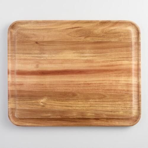 Crafted of acacia wood with a natural grain pattern that makes it your go-to for entertaining, our exclusive cutting board features a recessed trench that prevents juices from spilling over.